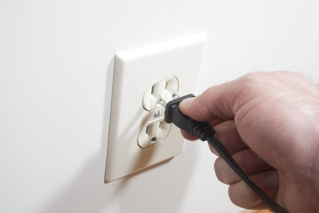 Issues putting a plug in a tamper resistant outlet